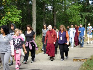 Bhante and Maureen walking